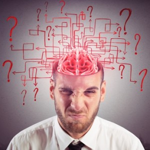 Brain of businessman with maze of questions